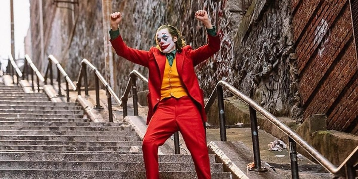 Joker dancing down the stairs