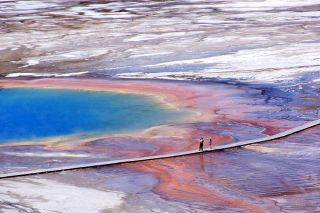 Yellowstone visitors view Grand Prismatic from a nearby boardwalk