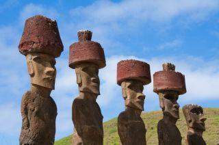 easter island statues wearing pukao