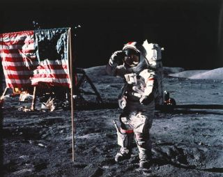 Apollo 17 commander Gene Cernan salutes the deployed United States flag on the lunar surface in December 1972.
