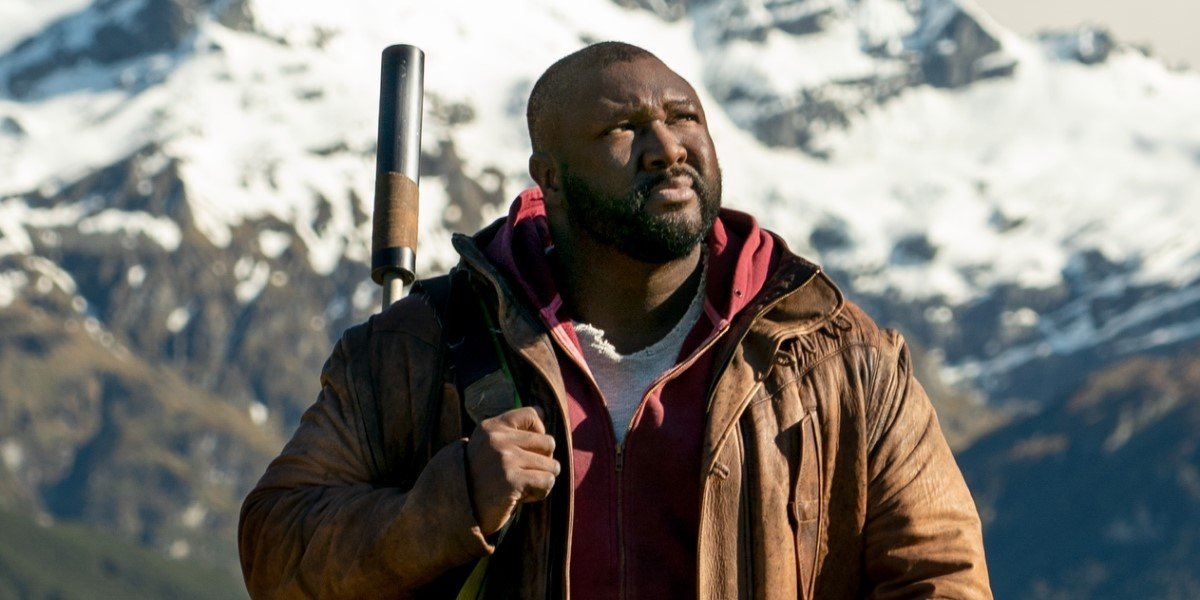 nonso anozie's jeppard standing in front of a mountain on sweet tooth