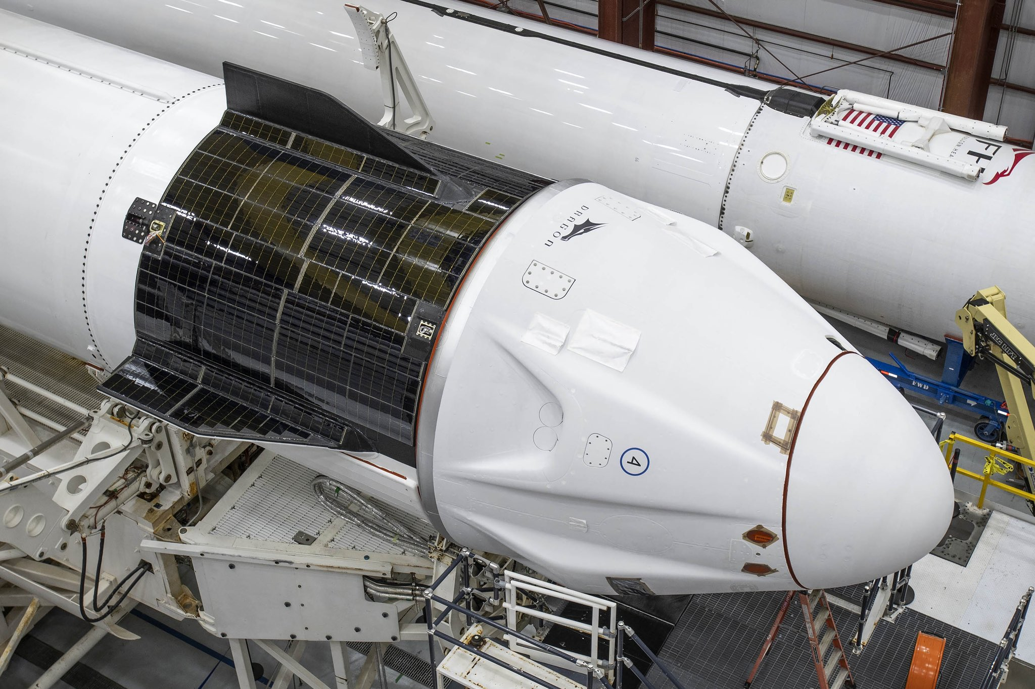 SpaceX's Crew Dragon Resilience is seen with the Inspiration4 mission logo inside its hangar ahead of a planned Sept. 15, 2021 launch from Pad 39A of NASA's Kennedy Space Center in Florida.