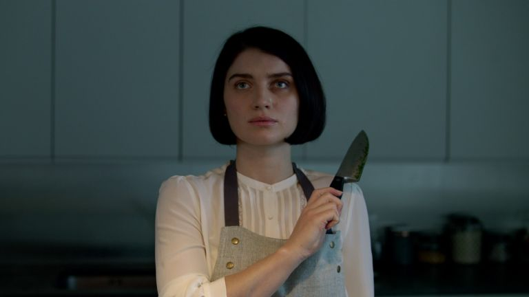 screen still from behind her eyes woman holding knife
