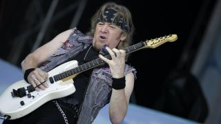 Iron Maiden's Adrian Smith onstage at Germany's Arena Oberhausen