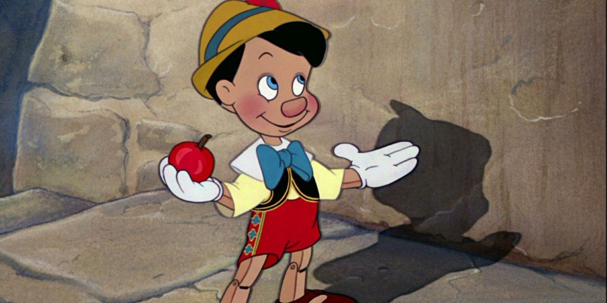 Pinocchio standing with an apple in hand