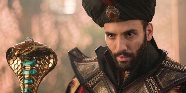 Aladdin Jafar using his staff to enchant a victim