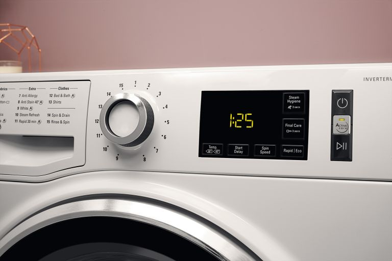 hotpoint washing symbols on machine dial close up