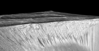 The dark streaks on some Martian slopes known as recurring slope lineae — imaged here by NASA's Mars Reconnaissance Orbiter — may be caused by salty liquid water, some scientists think.