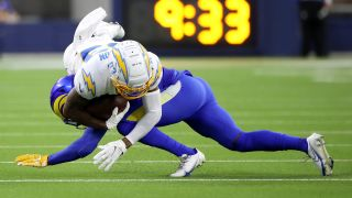 Brontae Harris #35 of the Los Angeles Rams tackles Tyron Johnson #83 of the Los Angeles Chargers during the first quarter during the preseason game at SoFi Stadium on Aug. 14, 2021 in Inglewood, California.