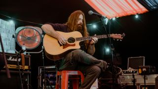 Mark Morton with an acoustic guitar