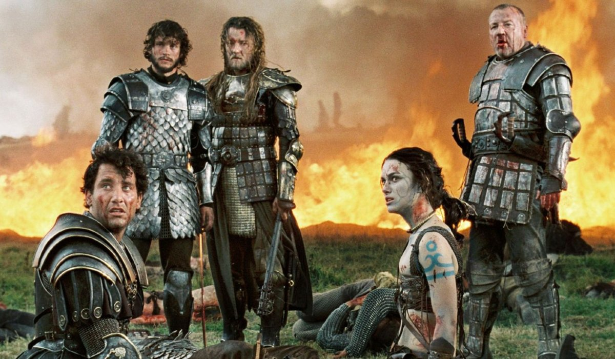 King Arthur Clive Owen and Keira Knightley, with their fellow warriors, sit in front of a burning fi