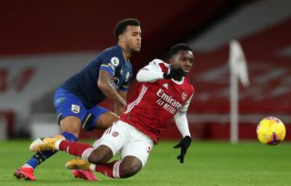 Southampton's Ryan Bertrand and Arsenal's Eddie Nketiah (right) battle for the ball during the Premier League match at the Emirates Stadium, London.