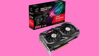 Asus Radeon RX 6600 XT på en rosa bakgrunn med kortets eske i bakgrunnen