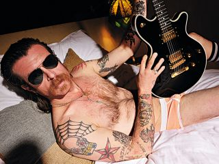 Jesse Hughes in bed with Total Guitar magazine (photograph: Jesse Wild)