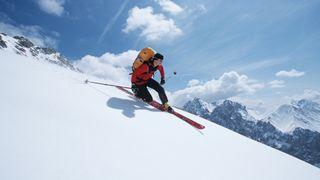 A man teleskiing downhill