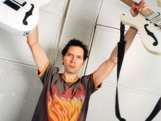 Paul Gilbert with his Ibanez PGM Signature guitar