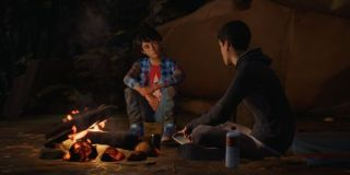 Daniel and Sean sitting around a campfire in Life is Strange 2