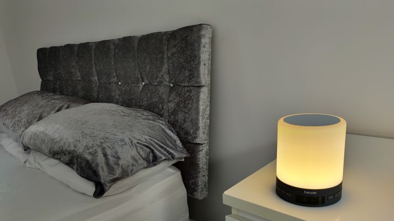 Beurer WL50 Wake Up Light on a bedside table next to bed