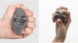 Face-shaped stress balls being squeezed