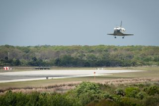 Space shuttle Discovery lands at Kennedy Space Center in Florida to complete its 39th and final flight.