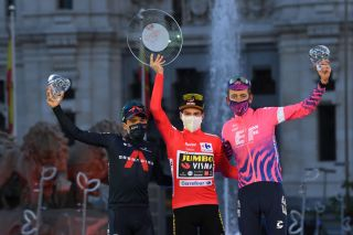 MADRID SPAIN NOVEMBER 08 Podium Richard Carapaz of Ecuador and Team INEOS Grenadiers Primoz Roglic of Slovenia and Team Jumbo Visma Red Leader Jersey Hugh Carthy of The United Kingdom and Team EF Pro Cycling Celebration Trophy Mask Covid safety measures Madrid Town Hall Plaza Cibeles Madrid City during the 75th Tour of Spain 2020 Stage 18 a 1396km stage from Hipdromo de la Zarzuela to Madrid lavuelta LaVuelta20 La Vuelta on November 08 2020 in Madrid Spain Photo by David RamosGetty Images