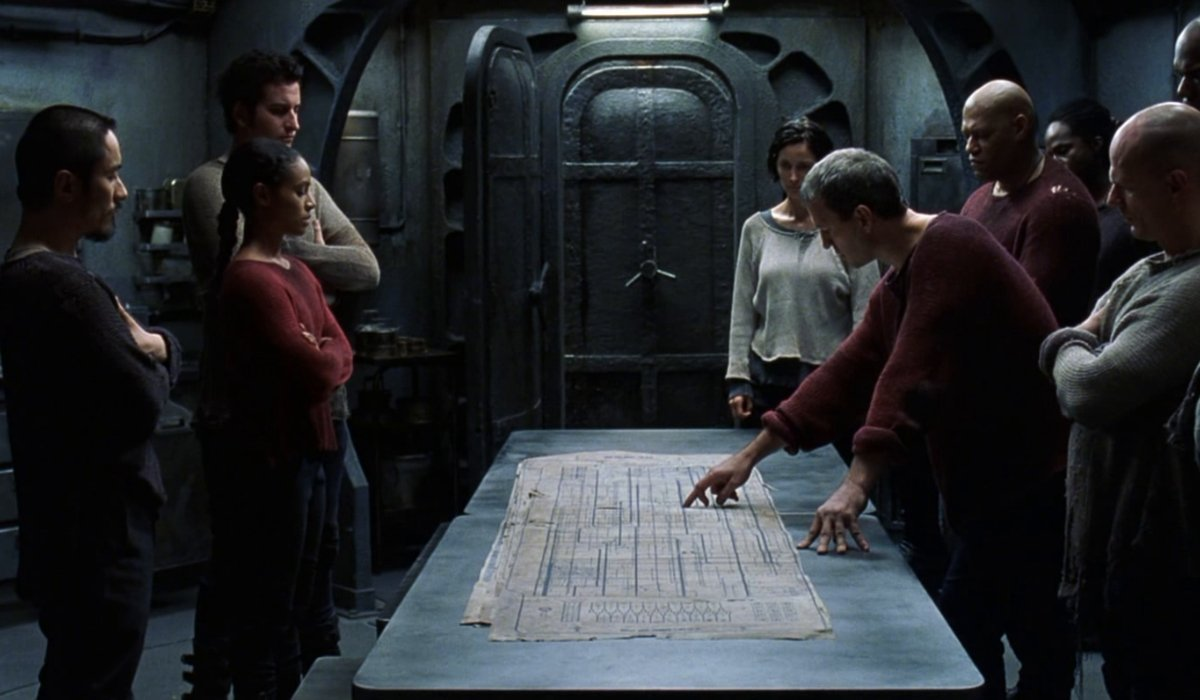 The Matrix Revolutions strategy meeting with Niobe, Trinity, Morpheus, and other officers