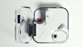 Top-down view of the transparent Nothing Ear 1 charging case with the lid open