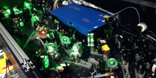 The ALPHA laser experiment, shown here, at the CERN lab in Switzerland is taking aim at antimatter mysteries.