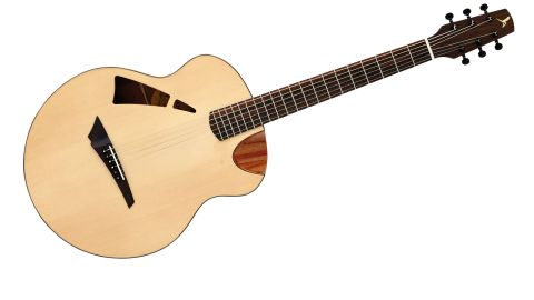The soundhole is a bit radical-looking, but it throws the sound to the player as well as the audience
