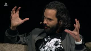 Naughty Dog creative director Neil Druckmann gestures on stage.