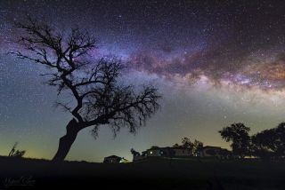 The Milky Way rises over the Nature Park of Noudar in Portugal's Dark Sky Alqueva.