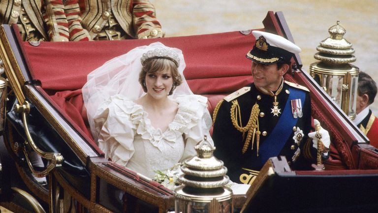 Prince Charles, Prince of Wales and Diana, Princess of Wales, in an open top carriage, from St. Paul's Cathedral to Buckingham Palace, following their wedding