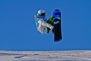 snowboarder doing a jump