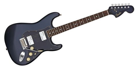 Body and headstock face are finished in Mercedes Blue, a dark blue with fine metallic fleck