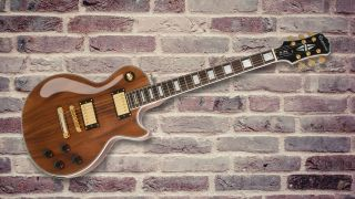 Turns heads with the Epiphone Les Paul Custom Pro Koa electric guitar, currently $120 off