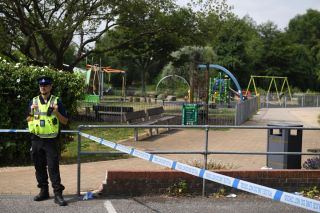 A police officer stands at a cordon by a play park at Queen Elizabeth Gardens in Salisbury, England, on July 5, 2018, after a man and woman were found unconscious after exposure with the nerve agent Novichok.