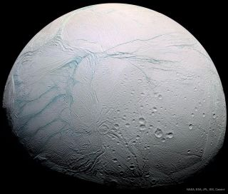 "An up-close look at the ""tiger stripes"" on Saturn's moon Enceladus, which is thought to harbor a big ocean of liquid water beneath its icy surface."