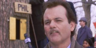 Groundhog Day Bill Murray tries to imitate a groundhog's face