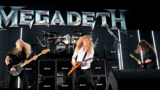 James Lomenzo, Dave Mustaine, and Kiko Loureiro of Megadeth performs on stage at the Germania Insurance Amphitheater in Austin, Texas on August 20, 2021.