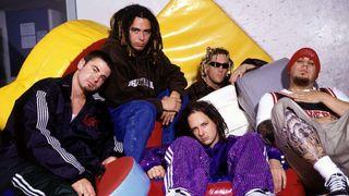 Korn sitting on crash mats
