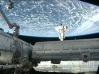 Shuttle Astronauts Make Midnight Docking at Space Station