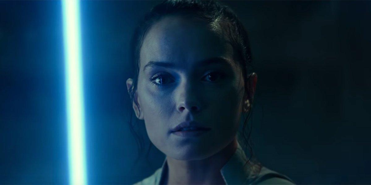 Rey wielding the Skywalker lightsaber