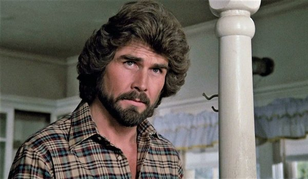 The Amityville Horror James Brolin looking a little concerned in a bedroom