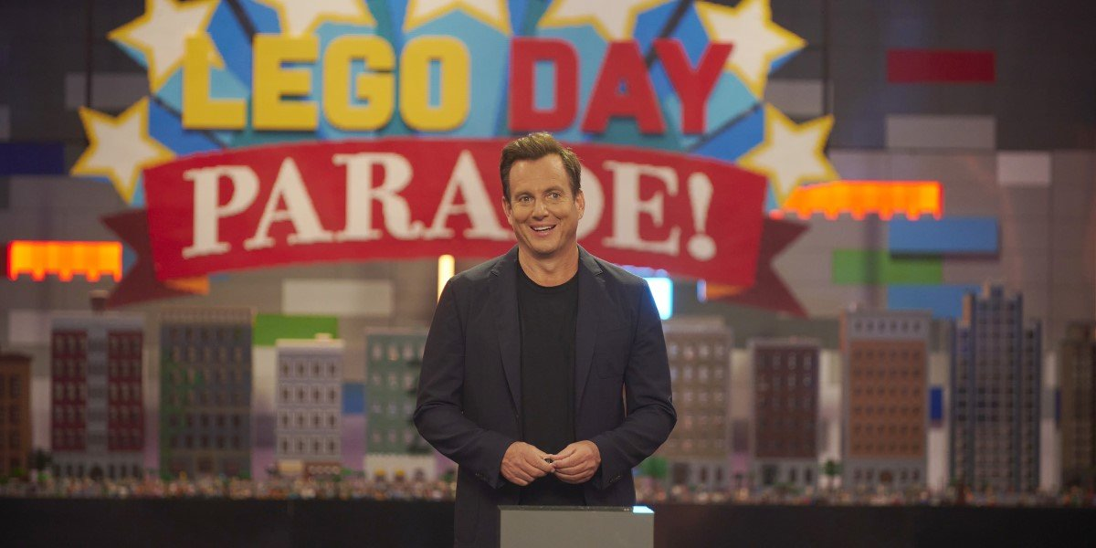 will arnett standing in front of LEGO skyscrapers on LEGO masters season 2 premiere