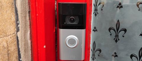 The Ring Video Doorbell 4 installed on a red door frame