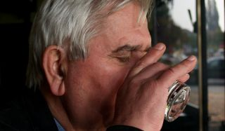 An older man drinking