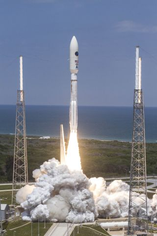 A United Launch Alliance Atlas 5 rocket launches the classified spy satellite NROL-67 into orbit for the National Reconnaissance Office on April 10, 2014 in a mission that lifted off from Space Launch Complex-41 at Cape Canaveral Air Force Station in Flor