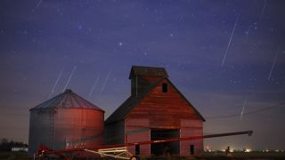 Meteors light up the skies over western Iowa during the Geminid meteor shower.