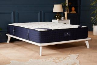 When to replace your mattress: mattress on a base in the middle of a room