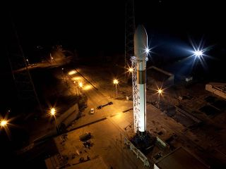 Falcon 9 standing vertically at Cape Canaveral.